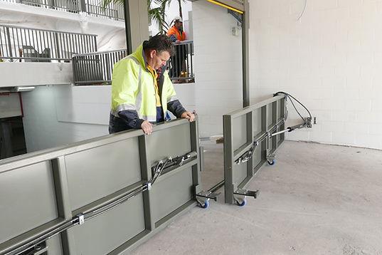 Installing hinged gate flood barrier.jpg