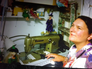 unbound soapme in my sewing room with industrial machine and the little barbies i redress as witches from fabric scraps..jpg