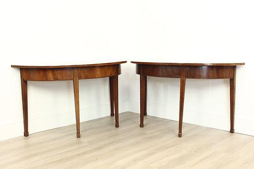 A Pair of Georgian Mahogany Semi Circle Console Tables