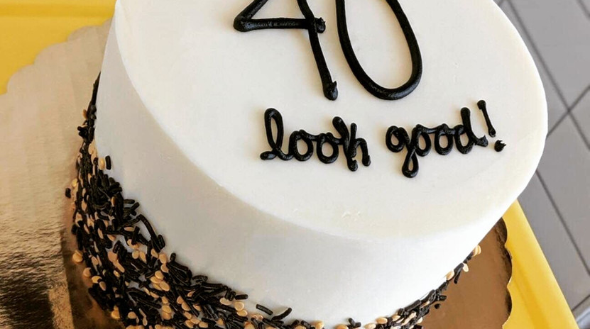 "6"" white cake with gold/black/silver sprinkles border"