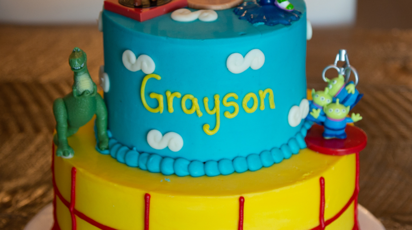 large 2tier TOY STORY inspired cake (you provide toys)