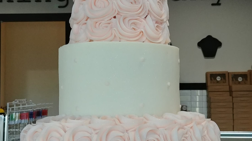 3 tier light pink rosettes with swiss dots