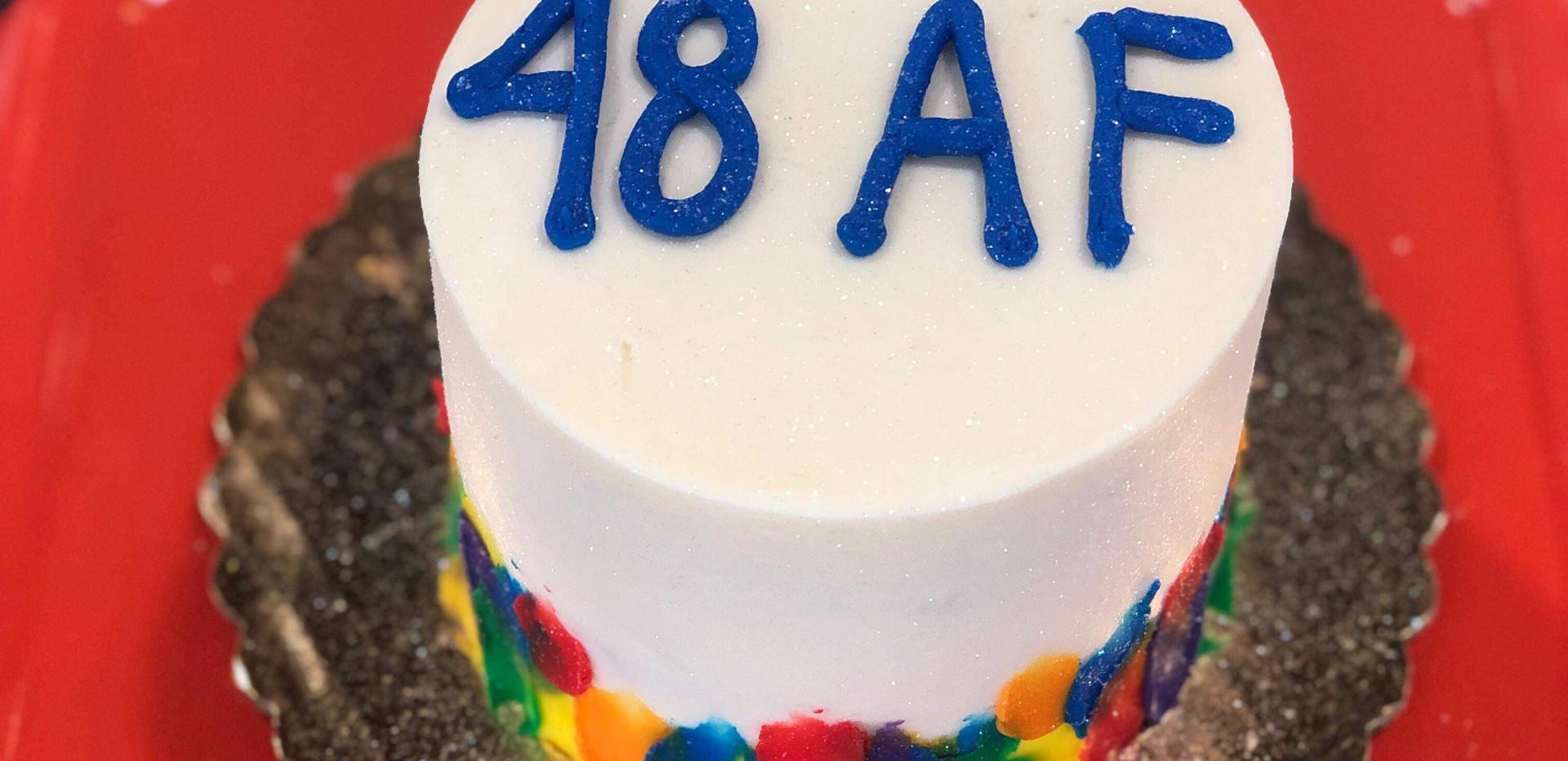 "4"" rainbow fuego border cake"