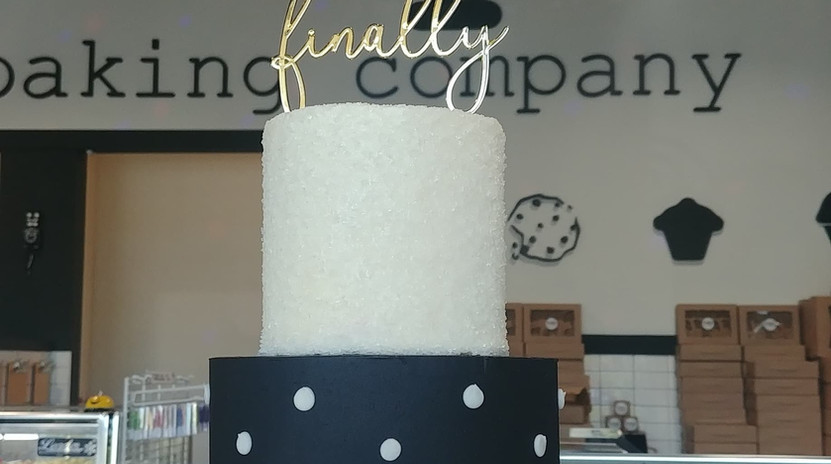 small 2tier black with white swiss dots cake