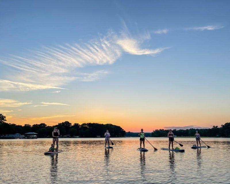 A paddleboarder glides along the Catawba River