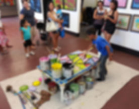 Cameron Sky Villa paints for an audience at a recent art exhibit.