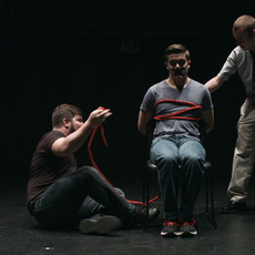W. Trent Welstead (Director, Producer) ensures that lead actor Jackson Tindall is comfortable while Alex Salvato (Key Grip) helps prepare Jackson for the 'Captive Actor' sequence.