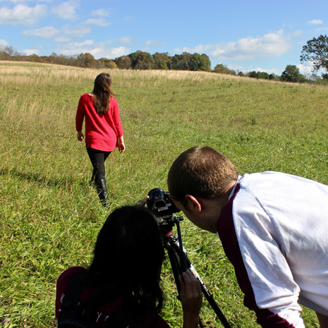 Catherine Crossett performs a camera test as Grant McMillan composes the canted angle shot.