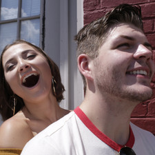 Molly McIntyre (Melissa) and Matt McDonough (Trey) posing for the candid photographs within the film.