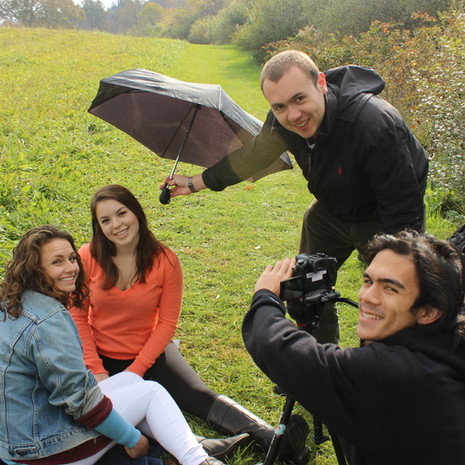 The cast and crew of Harmony pause for a promotional photo while attempting to troubleshoot a lighting inconsistency. From left to right, Madison Surry (Actress), Catherine Crossett (Actress), W. Trent Welstead (Director, Producer), Grant McMillan (DP).