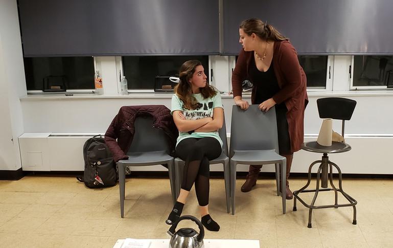 Sarah Hogan (Mary) and Emma Holland (Agatha) walk through the scene during an early rehearsal.
