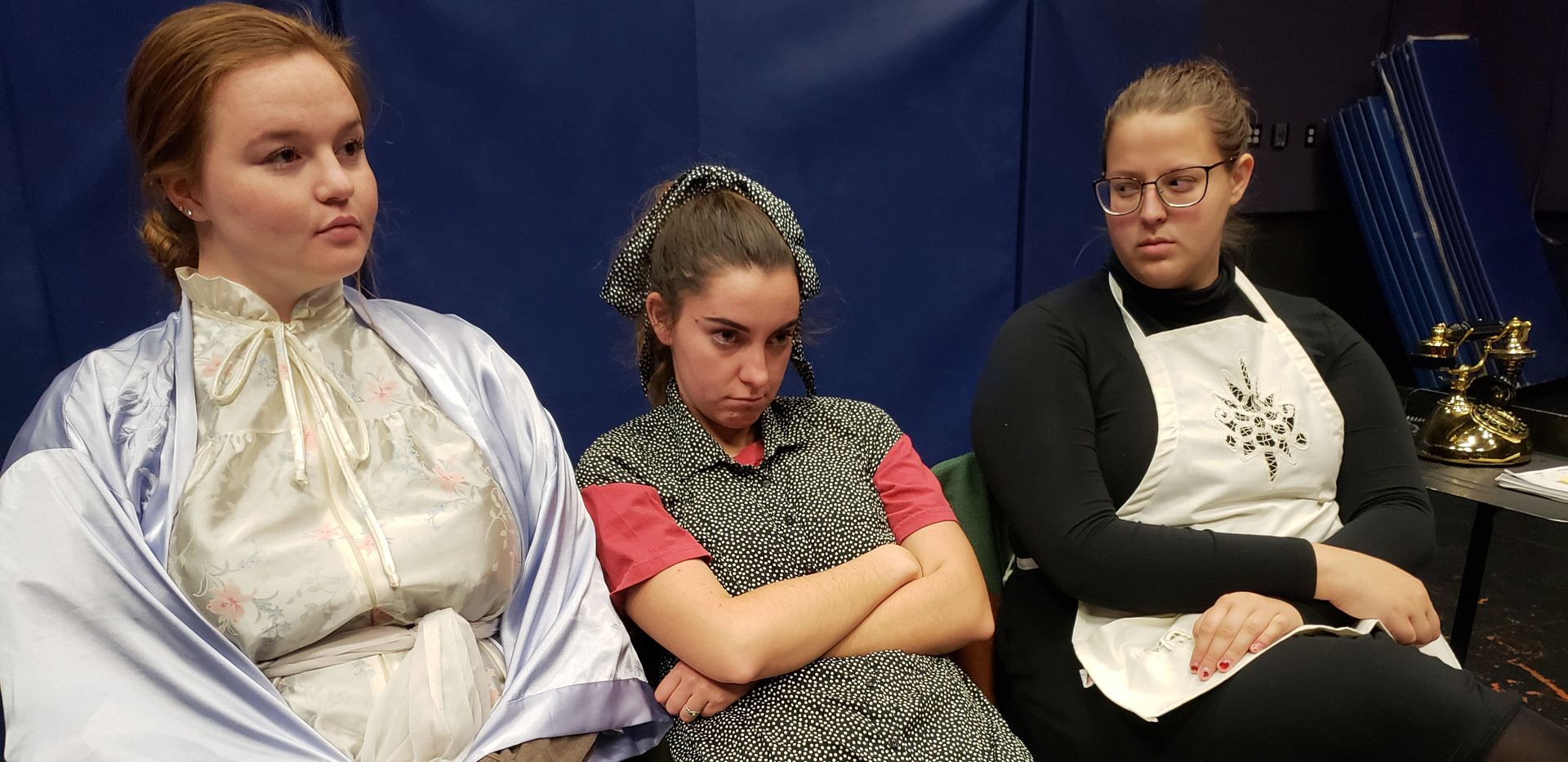 Promotional cast photo during dress rehearsal. From left to right, Sydney Kendrick (Mrs. Tilford, Sarah Hogan (Mary), and Emma Holland (Agatha).