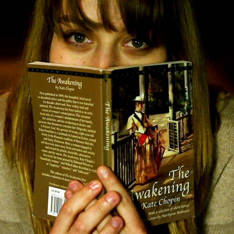 Micah Untiedt (Jane) hides behind her book during the 'Steps' sequence.