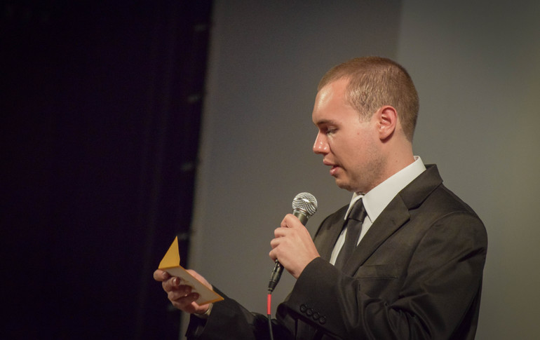 Festival Director, W. Trent Welstead, announcing an award at the 2018 Progeny Short Film Festival.