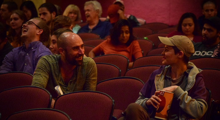 Virginia Tech Cinema Faculty, Justin Perkinson and Laura Iancu enjoy themselves as they await the start of the event.