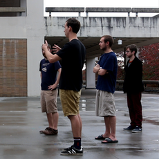 Mark Meardon (DP, Editor), discusses composition and choreography with the actors during the 'Creep' sequence.