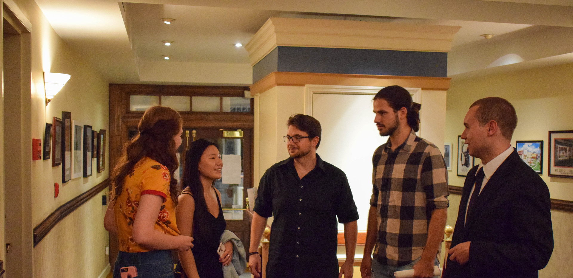 Festival Director W. Trent Welstead (right) interacting with the cast and crew of Disconnected.