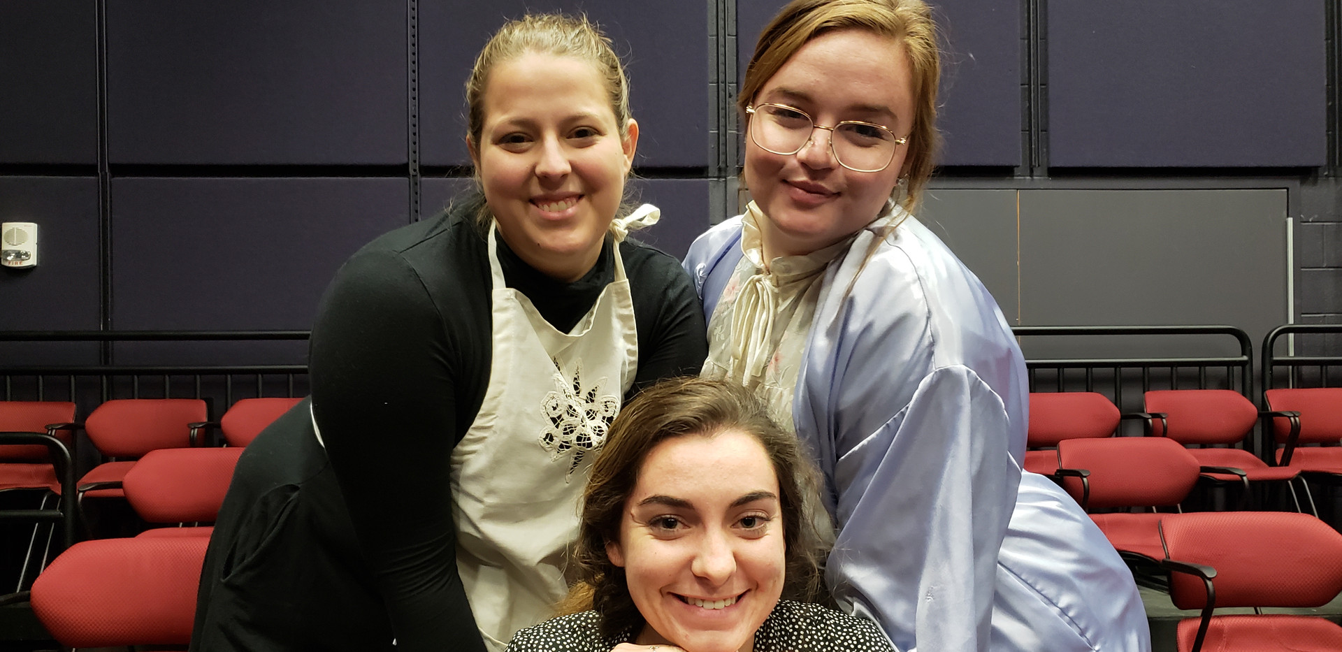 Promotional cast photograph during dress rehearsal. From left to right, Emma Holland (Agatha), Sarah Hogan (Mary Tilford), and Sydney Kendrick (Mrs. Tilford).
