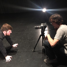 Alex Salvato (Key Grip) serves as a stand-in while Mark Meardon (DP, Editor) composes the shot.