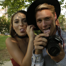 Molly McIntyre (Melissa) and Danny Purcell (The Photographer) posing for the candid photographs within the film.