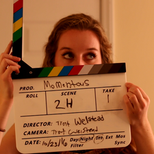 Maggie Gough (Christina) assists with slate duties for the skelleton crew.