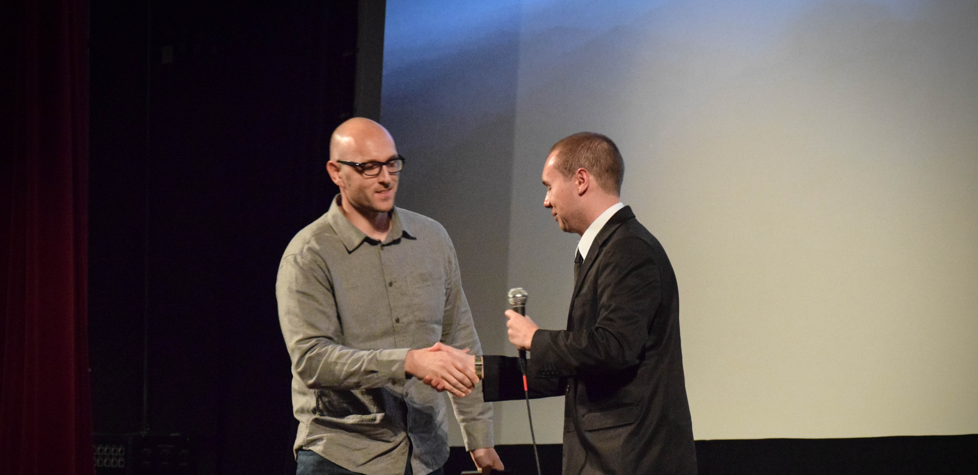 Filmmaker Christopher D. Lusk accepts his Best Cinematography Award for Prosperity.