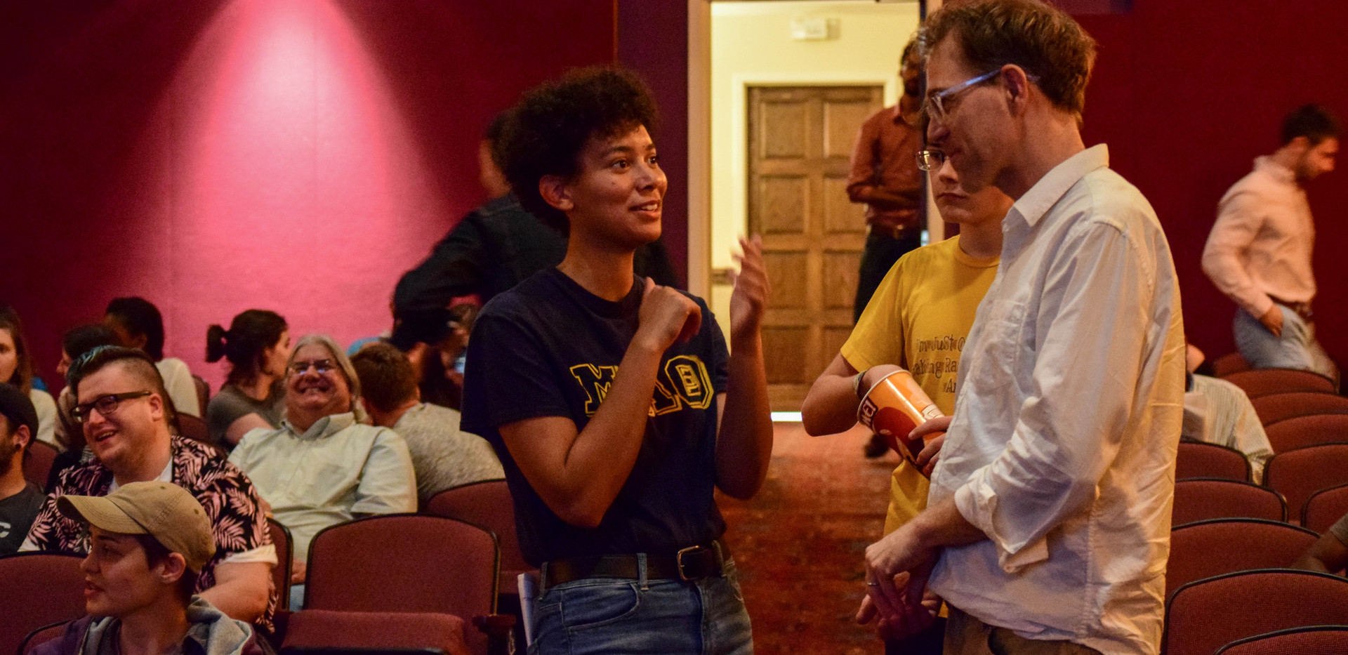 Faculty Advisor, Charles Dye (right), engaging with patrons during intermission.