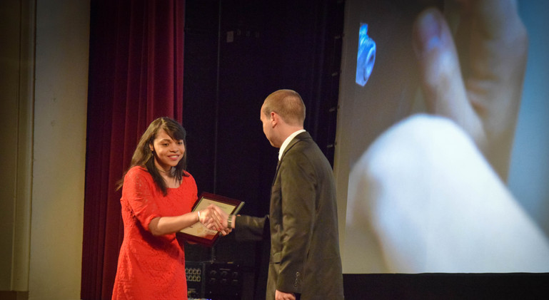 Jacinda Wallace accepts her Best Performance Award for her role in Tony Batchler Jr.'s Time of Ashes.