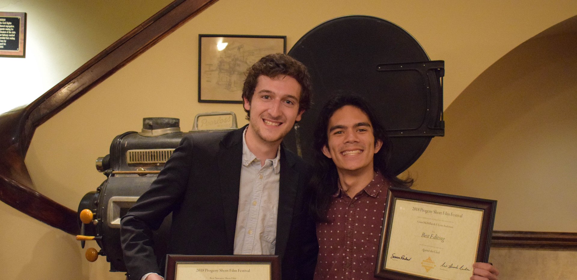 Matt Iglesias (left) and Grant McMillan (right) hold their respective Best Narrative Short Film and Best Editing awards for their short film, Against the Clock.