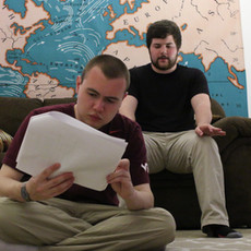 W. Trent Welstead (Writer, Producer) and Alex Salvato (Director) consulting the script while preparing for the shot.