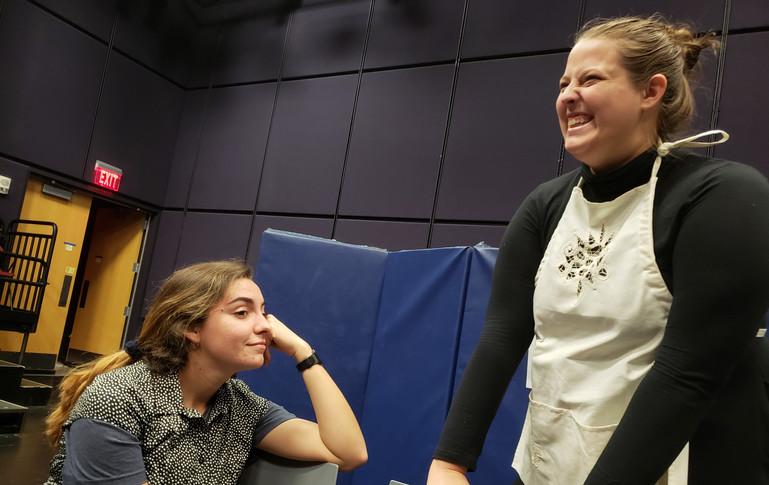 Late nights, and long laughs. Sarah Hogan (Mary) and Emma Holland (Agatha) take a break during dress rehearsal.