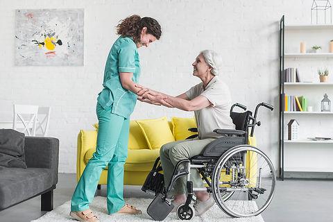 caregiver-helping-senior-female-patient-