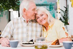 loving-elderly-couple-drinking-tea-with-