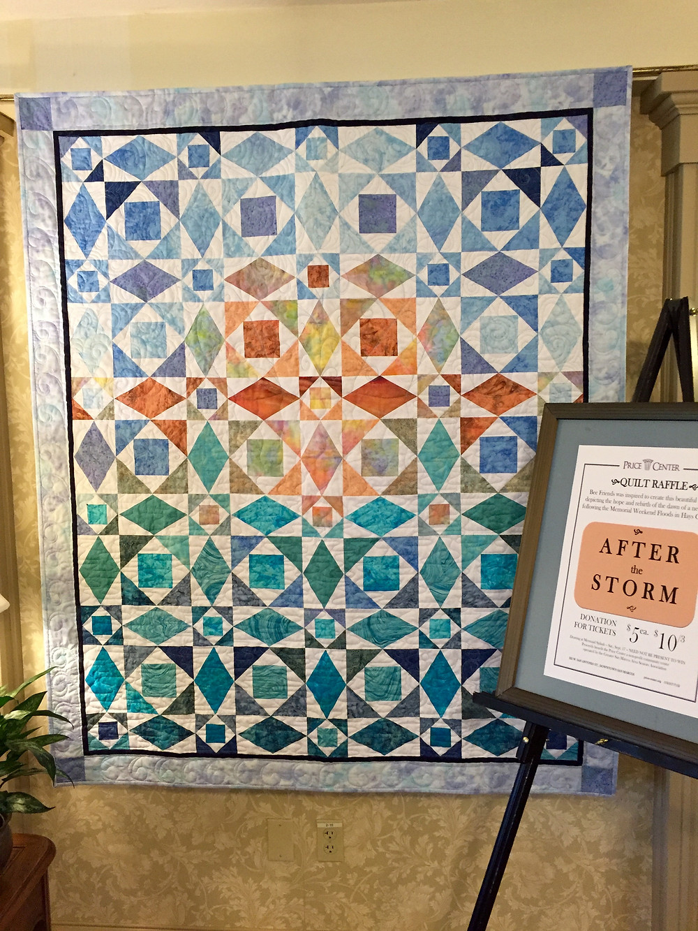 "Visitors to the Center on Sept.11 with have another chance to purchase a raffle ticket for this beautiful quilt depicting the dawn of a new day and the hope it inspires. The piece includes two ""hidden"" mermaids embedded in the quilting. The winner of the raffle will be announced at the Mermaid Splash on Sept. 17."