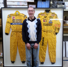 Two F1 Racing suits framed