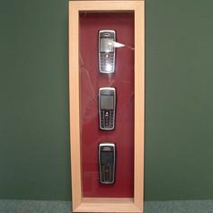 Three Mobile Phones framed in box frame