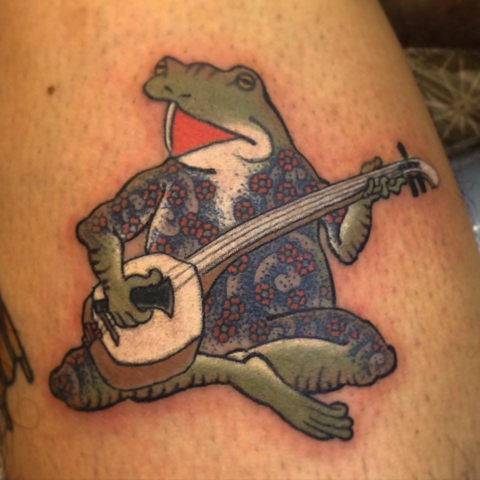 Tattooed Frog singing Shamisen