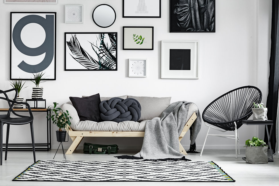 Wooden sofa with dark pillows in scandi