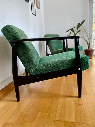 A pair of green midcentury easy chair