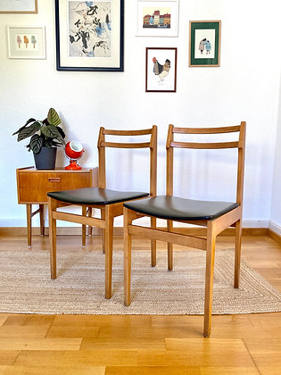 A pair of wooden Scandi style dining chairs