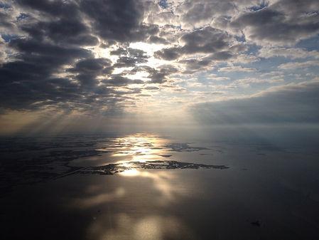 sun-poking-through-clouds.jpg