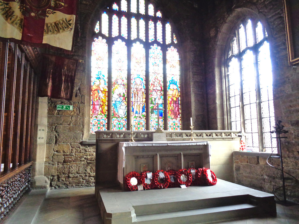 Minster chapel, with Poppy wreaths for rememberance at the altar, and standards from the Duke of Wellington's Regiment