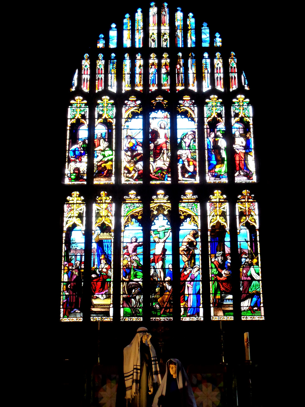 Halifax Minster's chancel window, depicting the Crucifixion, with a Nativity scene in front