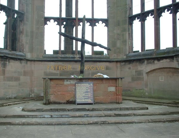 The burnt cross over the altar in the ruins of Coventry Cathedral