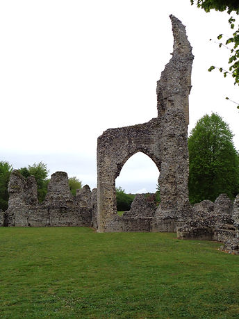 The ruins of Thetford Priory, a crooked spire left by a collapsed archway