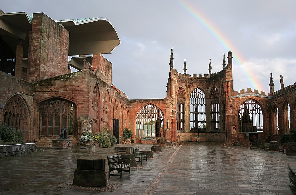 The new (left) and old (right) cathedral buildings, with a rainbow.