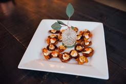 sweet potato chip, spiced& whipped mascarpone, caramelized onion, edible flower