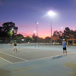 beautiful sunset playing tennis