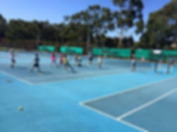 kids playing tennis games on tennis court