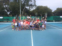 kids having fun at school holiday tennis clinic
